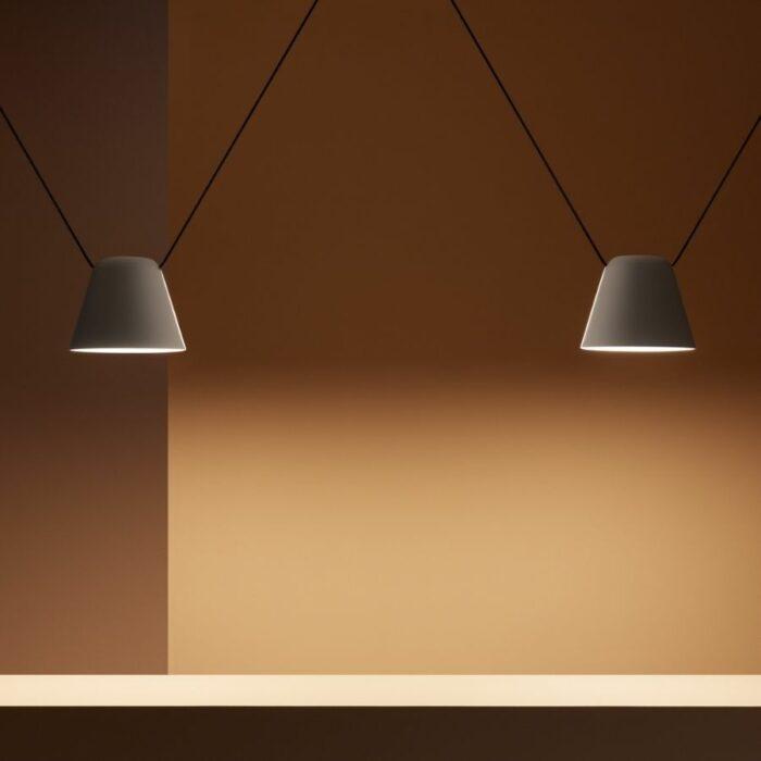 Atticus 2 light white pendant over a table