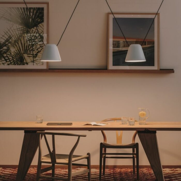 Atticus 2 light white pendant over a dining table