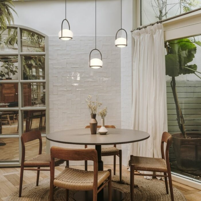 Koko cluster of single pendant lights over a dining table