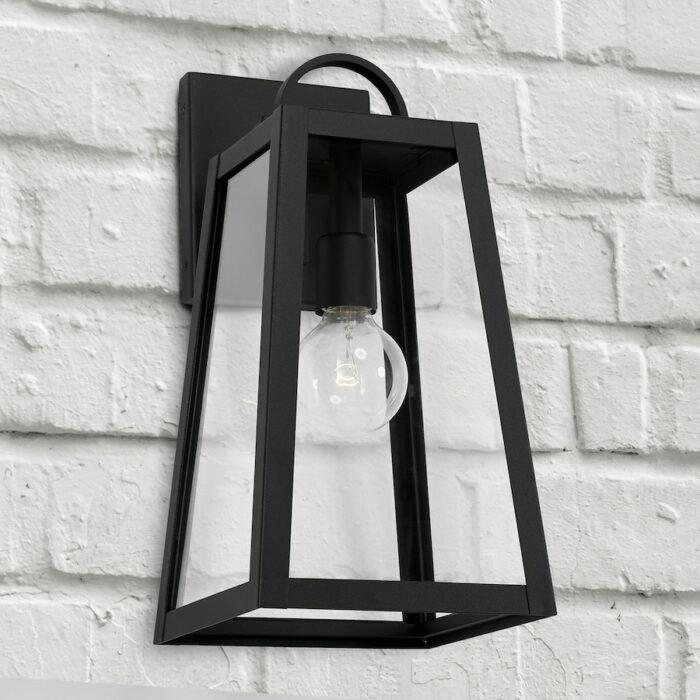 Lewis 1 light black exterior wall lantern on white brick wall