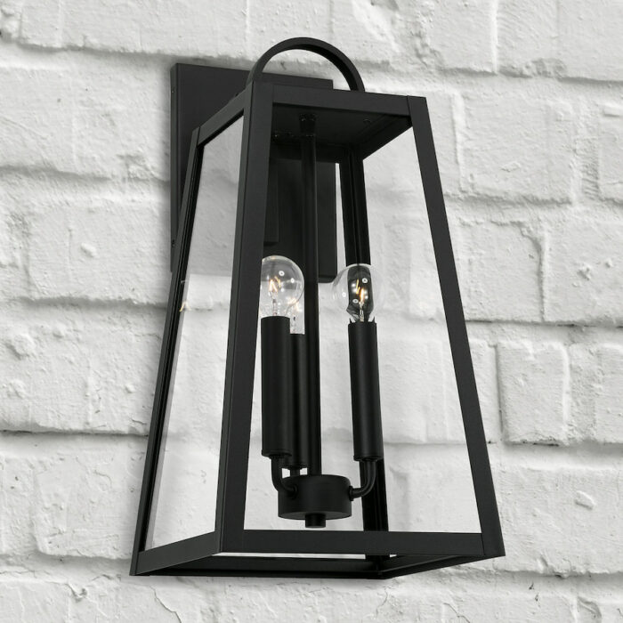 Lewis 3 light black exterior wall lantern on white brick wall