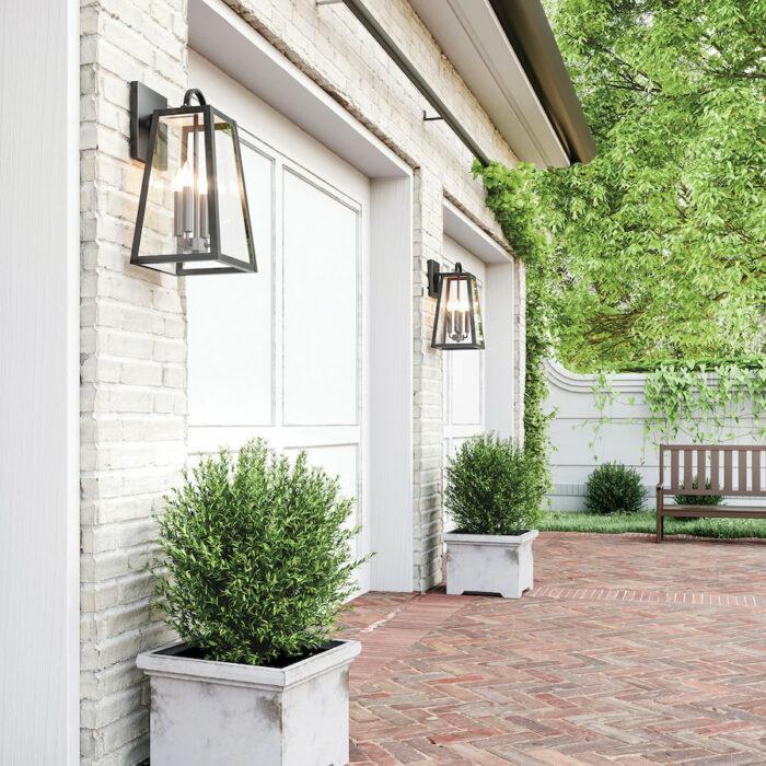 Lewis 4 light black exterior wall lantern on white brick wall outside garage