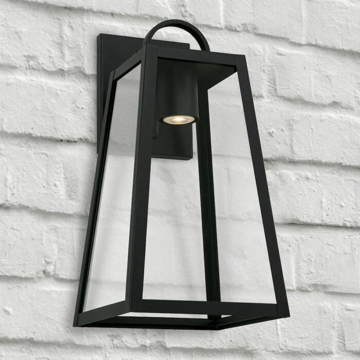 Lewis black exterior wall lantern with GU10 downlight on white brick wall