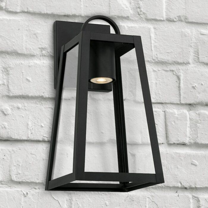 Lewis small black exterior wall lantern with GU10 downlight on white brick wall