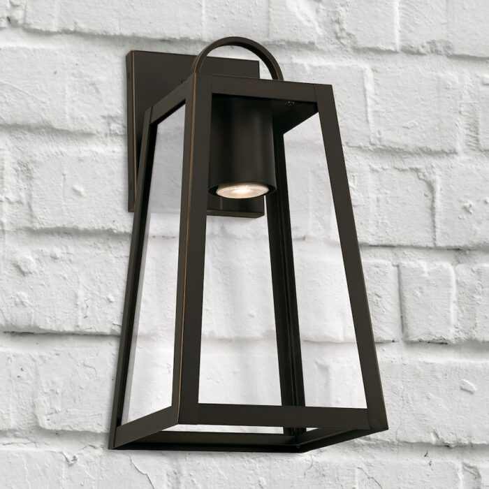 Lewis small bronze exterior wall lantern with GU10 downlight on white brick wall